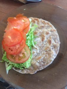 chapati bread with avocado lettuce tomato and garlic