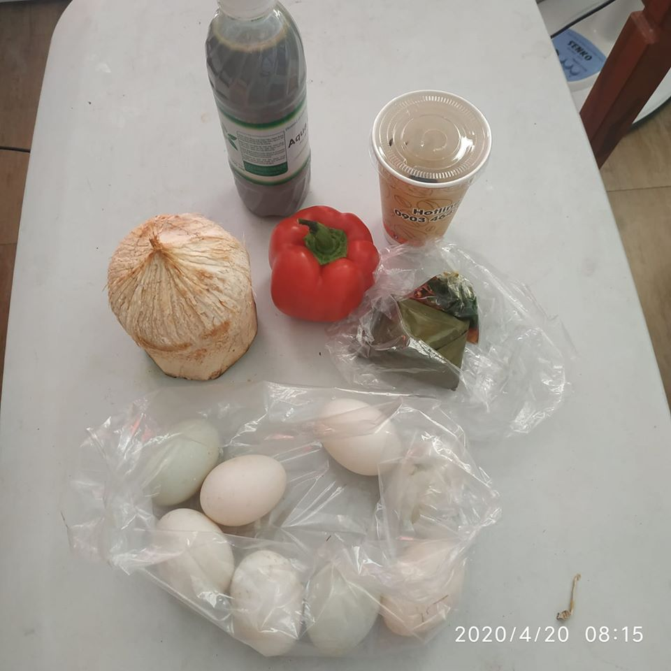Clockwise from top left: Black sesame seed milk, coffee, Banh It ( rice cake ), duck eggs, coconut, and red pepper